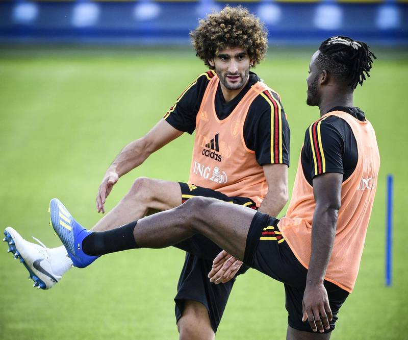 Belgium's forward Michy Batshuayi (R) and midfielder Marouane Fellaini attend a training session in Dedovsk on June 25, 2018, ahead of the 2018 World Cup Group G Football match between England and Belgium.  / AFP / Alexander NEMENOV