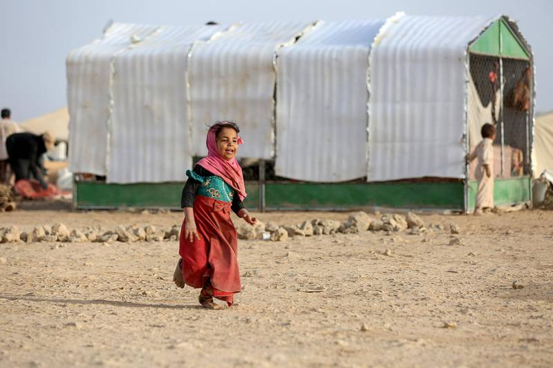 A girl walks past a tent at a camp for internally displaced people (IDPs) in Marib, Yemen April 5, 2021. Picture taken April 5, 2021. REUTERS/Ali Owidha