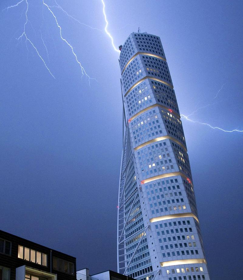 Lightning strikes the 190 m (623 ft)-high Turning Torso building in Malmo early morning on June 7, 2011. As the unseasonally hot weather was replaced by cooler winds, heavy rain and thunderstorms struck Sweden's South-west coast. AFP PHOTO / SCANPIX - JOHAN NILSSON (Photo by JOHAN NILSSON / SCANPIX SWEDEN / AFP)
