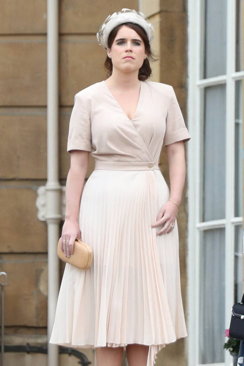 Britain's Princess Eugenie of York and Britain's Princess Beatrice of York arrive at the Queen's Garden Party at Buckingham Palace, central London on May 29, 2019. (Photo by Yui Mok / POOL / AFP)