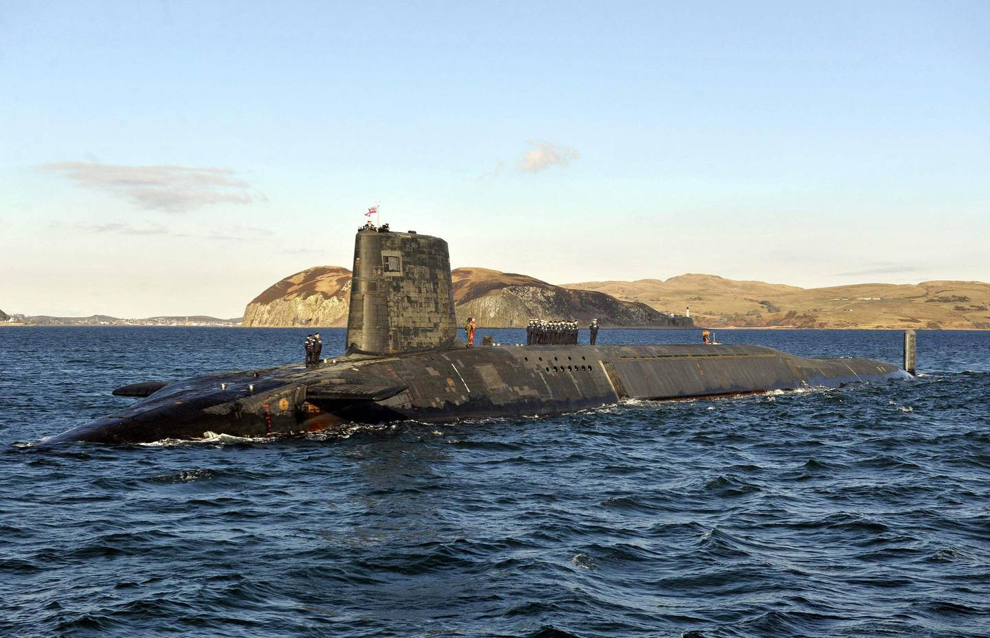 """(FILES) In this file photo taken on April 4, 2013 A picture shows the Trident Nuclear Submarine, HMS Victorious, on patrol off the west coast of Scotland. Russia's ambassador to Britain said on March 21, 2021 that diplomatic ties between the two countries were """"nearly dead"""", after a UK strategic review this week branded Moscow an """"acute direct threat"""". Andrei Kelin also criticised Britain's decision to bolster its nuclear stockpile, arguing the reversal of decades of policy was a violation of various international agreements.  / AFP / Andy Buchanan"""