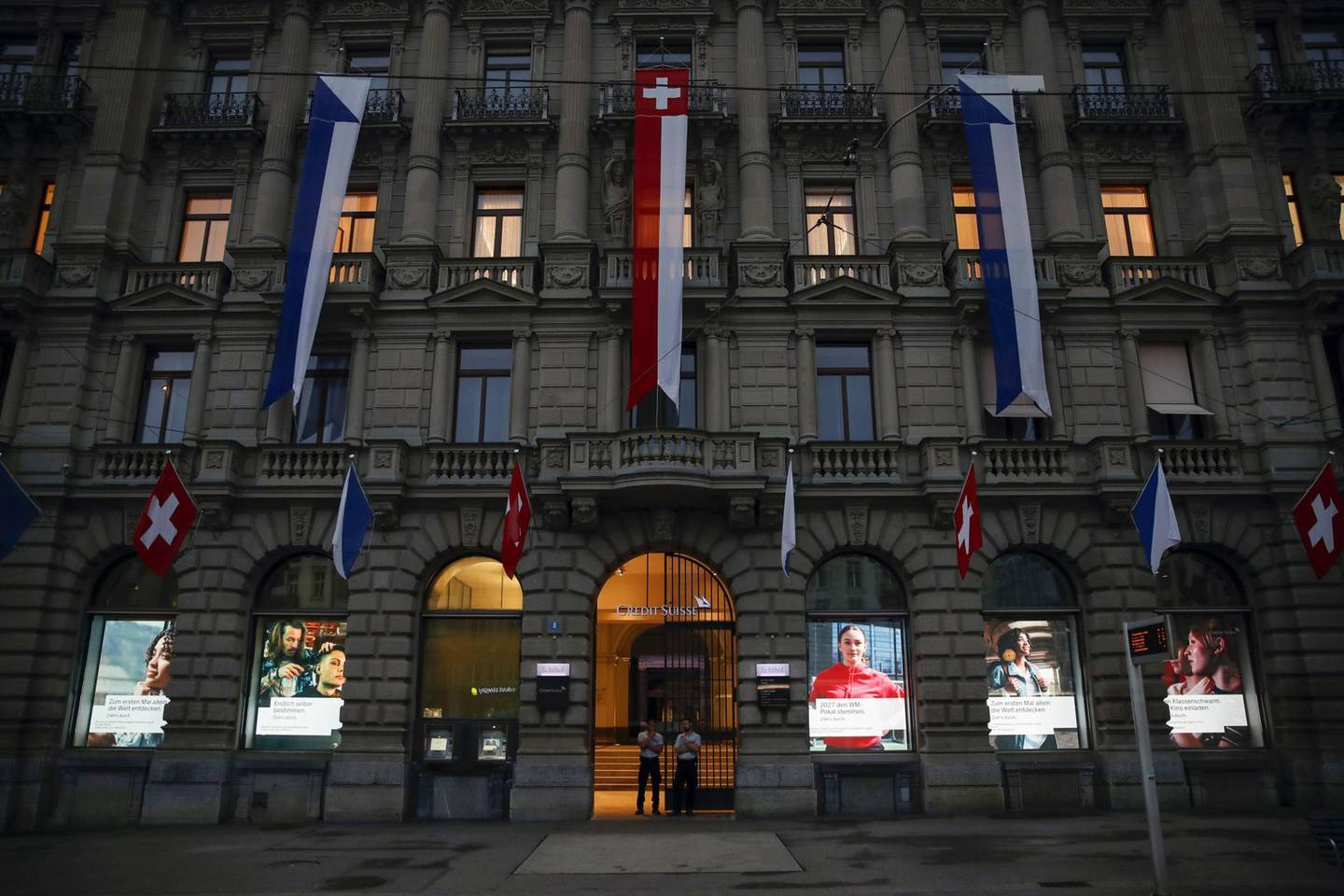 Security stands at the entrance to Credit Suisse Group AG's headquarters in Zurich, Switzerland, on Wednesday, Jul. 31, 2019.Photographer: Stefan Wermuth/Bloomberg