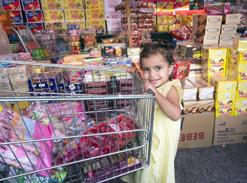 RAS AL KHAIMAH, UNITED ARAB EMIRATES, 26 APRIL 2018- Locals buying sweets in Saif Mirza store one of the stores selling sweets and nuts for Hag Al Leila in Ras Al khaimah. Leslie Pableo for The National for Anna Zackarias story