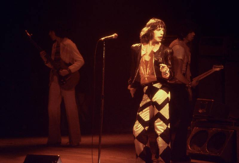"""Mick Jagger, lead singer of the rock group the """"Rolling Stones"""" performs with his band in Glasgow in May 1982.   (FILM) AFP PHOTO (Photo by PA / AFP)"""