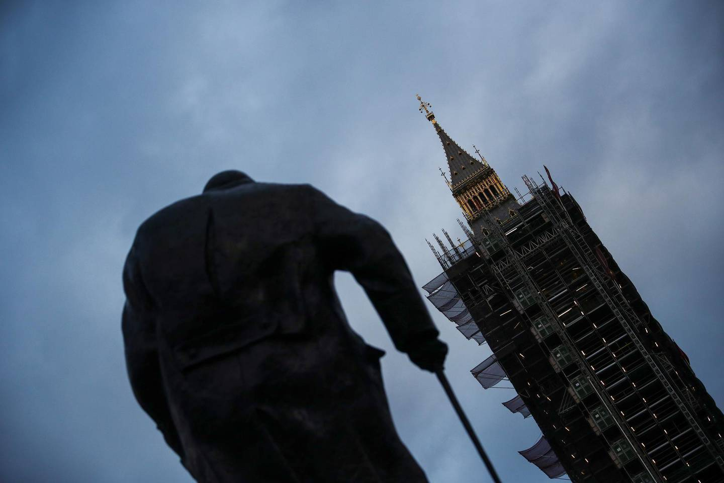 A view shows a statue of Winston Churchill standing in front of Big Ben amidst the spread of the coronavirus disease (COVID-19) pandemic, in London, Britain December 24, 2020. REUTERS/Hannah McKay