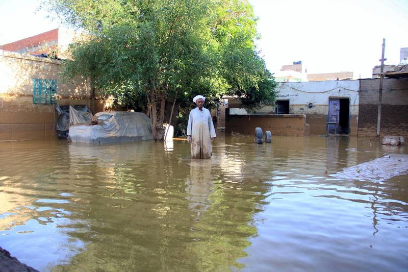 A picture taken October 29, 2016 shows a local man inspecting the damage following heavy floods in Ras Gharib, near the mouth of the Gulf of Suez in the Red Sea governorate, after flooding in parts of Egypt caused by torrential rains. - At least 22 people were killed and 72 injured in flooding in parts of Egypt caused by torrential rains, authorities said, updating an earlier toll of 18 dead. Ras Gharib, was the worst hit area with nine people killed in the flooding. (Photo by Mostafa EL-SHEMY / AFP)