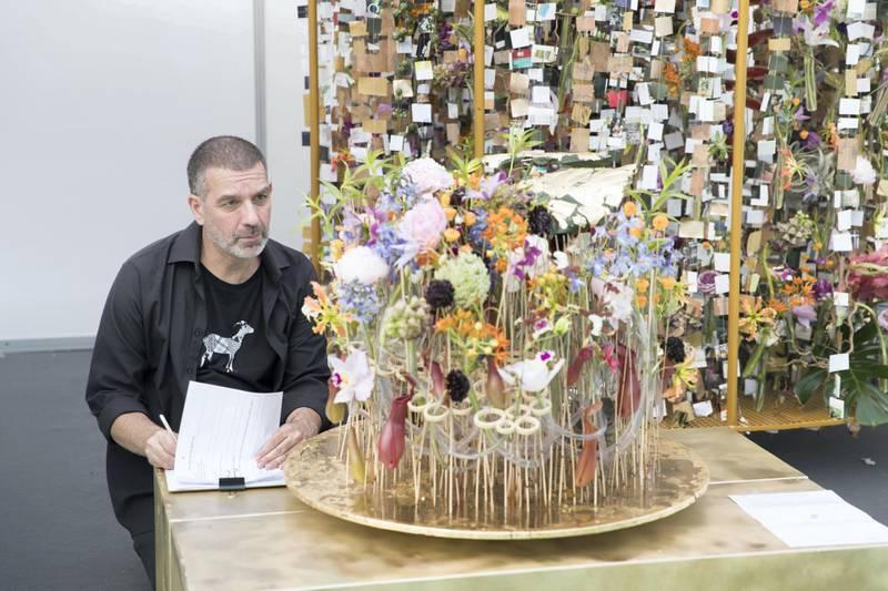 DUBAI, UNITED ARAB EMIRATES - Feb 22, 2018.  A judge assesses Tamas Mezoffy, Hungary, floral arrangements at Dubai International Flower Festival.  (Photo: Reem Mohammed/ The National)  Reporter: Melanie Hunt Section: WK