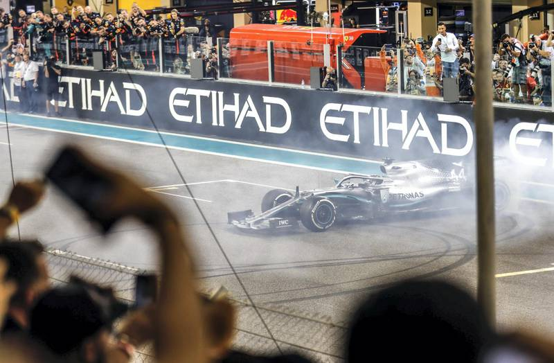 Abu Dhabi, United Arab Emirates, December 1, 2019.   Formula 1 Etihad Airways Abu Dhabi Grand Prix. --   Lewis Hamilton (Mercedes)   makes a burnout victory after taking the World Championship Formula1 title. Victor Besa / The National Section:  SP Reporter:  Simon Wilgress-Pipe