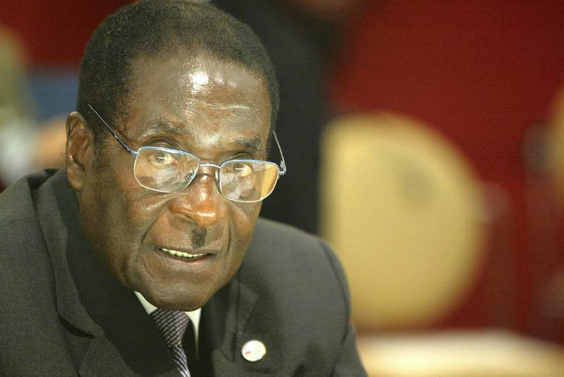 PARIS - FEBRUARY 21:  President of Zimbabwe Robert Mugabe in the 22nd African Heads of State Conference on February 21, 2003 in Paris, France. The Summit will focus on development and investment, Aids/HIV trade and conflict resolution with particular reference to the Ivory Coast.  (Photo by Pascal Le Segretain/Getty Images)