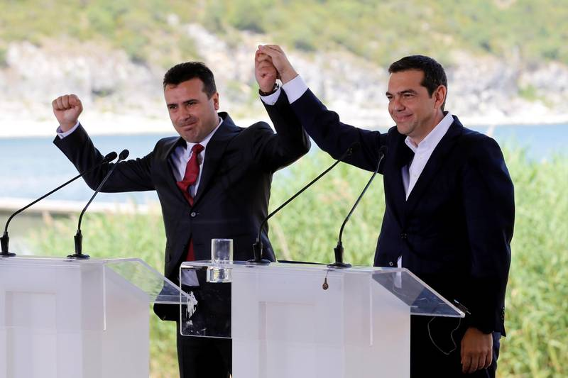 Greek Prime Minister Alexis Tsipras and Macedonian Prime Minister Zoran Zaev gesture before the signing of an accord to settle a long dispute over the former Yugoslav republic's name in the village of Psarades, in Prespes, Greece, June 17, 2018. REUTERS/Alkis Konstantinidis