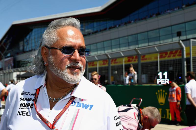 NORTHAMPTON, ENGLAND - JULY 08: Force India Chairman Vijay Mallya on the grid before the Formula One Grand Prix of Great Britain at Silverstone on July 8, 2018 in Northampton, England.  (Photo by Mark Thompson/Getty Images)
