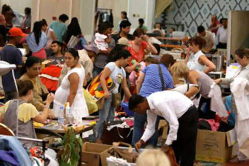 DUBAI, UNITED ARAB EMIRATES, July 17: People buying different items in the flea market held at Jumeirah ballroom in Crowne Plaza hotel in Dubai. (Pawan Singh / The National) For News. Story by Leah