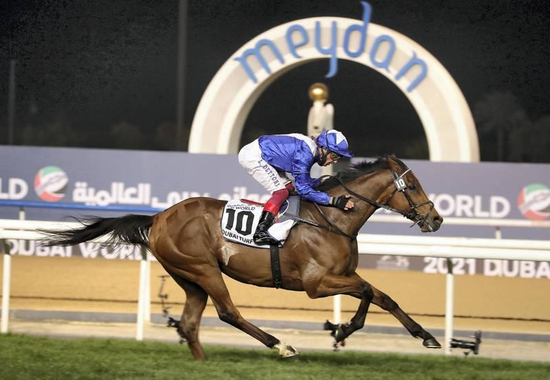 DUBAI , UNITED ARAB EMIRATES , MARCH 27  – 2021 :-  LORD NORTH  (IRE) ridden by LANFRANCO DETTORI ( no 10  ) won the 7th  horse race Dubai Turf 1800m Turf  during the Dubai World Cup held at Meydan Racecourse in Dubai. ( Pawan Singh / The National ) For News/Sports/Instagram/Big Picture. Story by Amith