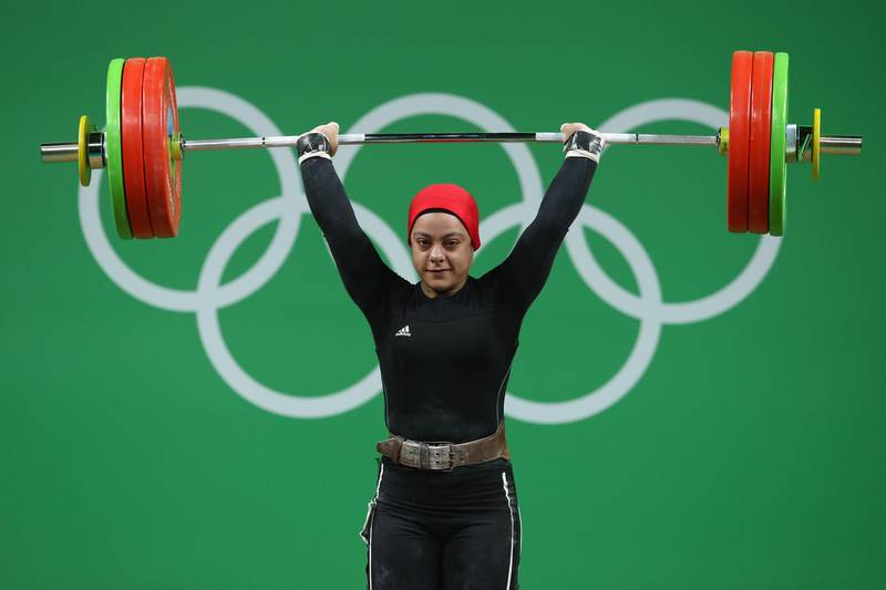 RIO DE JANEIRO, BRAZIL - AUGUST 10:  Sara Ahmed of Egypt lifts during the Women's 69kg Group A weightlifting contest on Day 5 of the Rio 2016 Olympic Games at Riocentro - Pavilion 2 on August 10, 2016 in Rio de Janeiro, Brazil.  (Photo by Julian Finney/Getty Images)