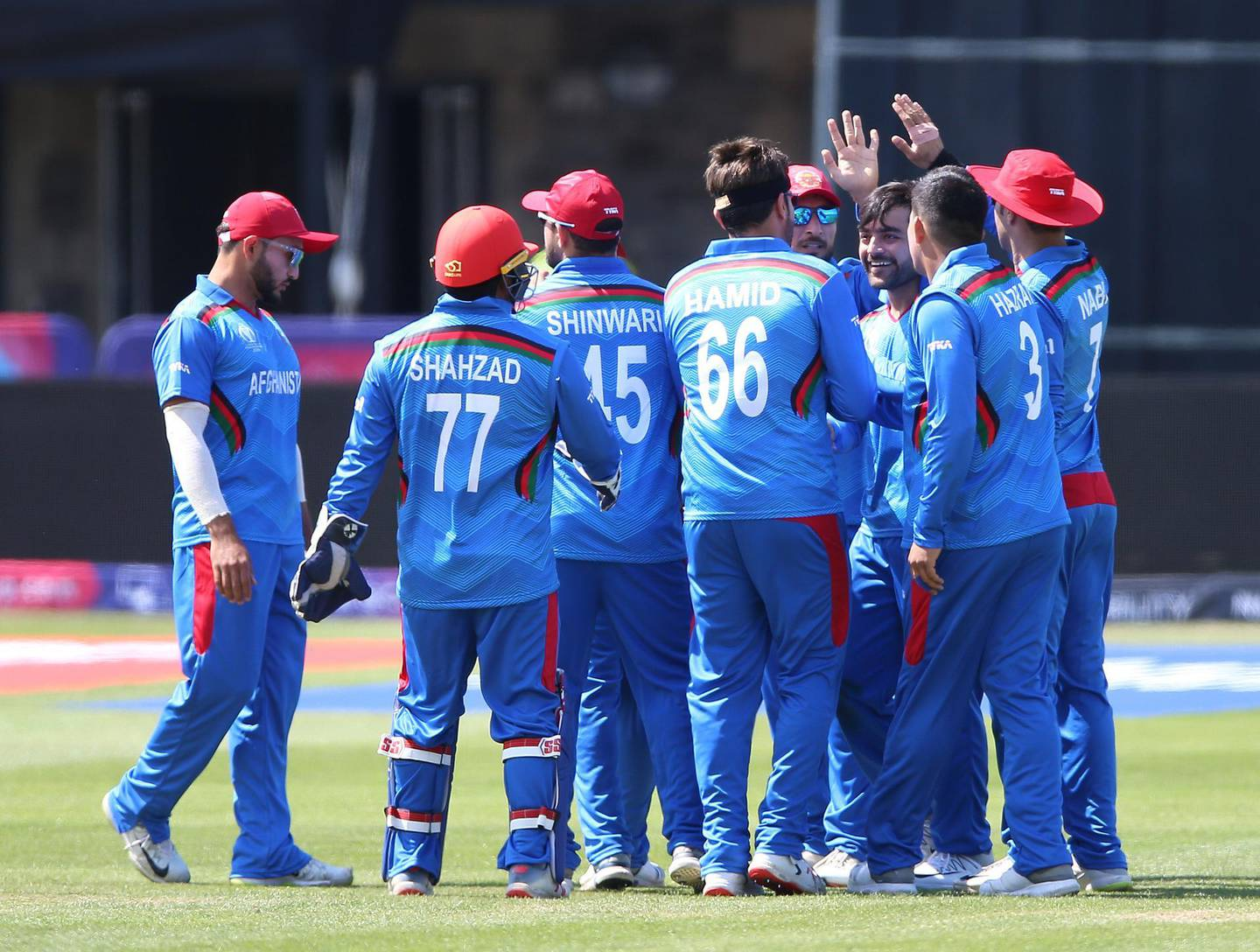 Afghanistan's players celebrate after taking the wicket of Pakistan's Mohammad Hafeez during the ICC Cricket World Cup Warm up match at The Bristol County Ground. PRESS ASSOCIATION Photo. Picture date: Friday May 24, 2019. See PA story CRICKET Pakistan. Photo credit should read: Nigel French/PA Wire. RESTRICTIONS: Editorial use only. No commercial use. Still image use only.