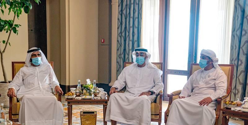 ABU DHABI, UNITED ARAB EMIRATES - July 10, 2020: HH Sheikh Mohamed bin Zayed Al Nahyan, Crown Prince of Abu Dhabi and Deputy Supreme Commander of the UAE Armed Forces (C), meets with HH Sheikh Mohamed bin Rashid Al Maktoum, Vice-President, Prime Minister of the UAE, Ruler of Dubai and Minister of Defence (L). Seen with HH Sheikh Hamdan bin Zayed Al Nahyan, Ruler's Representative in Al Dhafra Region (R).  ( Hamad Al Kaabi  / Ministry of Presidential Affairs ) ---