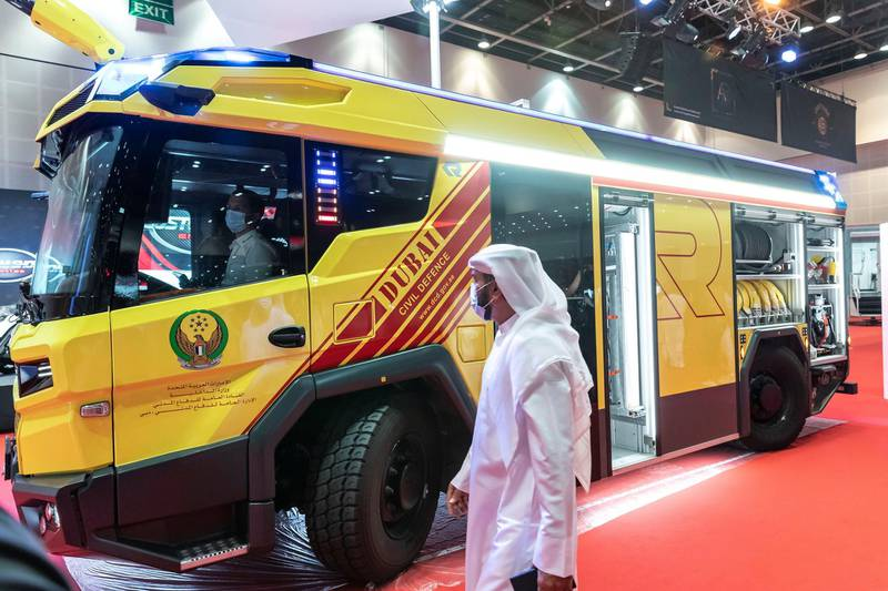 DUBAI, UNITED ARAB EMIRATES. 08 APRIL 2021. The newly launced fully electric Rosenbauer RT (Revolutionary Technology) Fire engine launched at the Custom Show Emirates. This fully electric municipal fire engine features amongst other aspects a Volvo Penta electric drivetrain, drive power of dual engines producing 350 kW, a diesel-powered BMW Range Extender, two high-voltage batteries with 100 kWh of available capacity and a Electronic stability program with additional rear axle steering (all-wheel steering) for optimized maneuverability. The Firefighting equipment include a NH35 pump.  a pump drive with generator (electrical) or with diesel engine (mechanical) option, and a foam proportioning system. It has a tank volume of 2,000 l water and 200 l foam compound. Pressure outlets on the front and sides make for an ol round fire fighting platform. (Photo: Antonie Robertson/The National) Journalist: Michael Fahy. Section: Business.