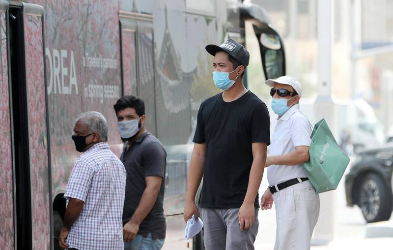 ABU DHABI, UNITED ARAB EMIRATES , June 1 – 2020 :- People wearing protective face mask as a preventive measure against the spread of coronavirus at the bus stop in Abu Dhabi. UAE government lifts the coronavirus restriction for the residents and businesses around the country. (Pawan Singh / The National) For News/Stock