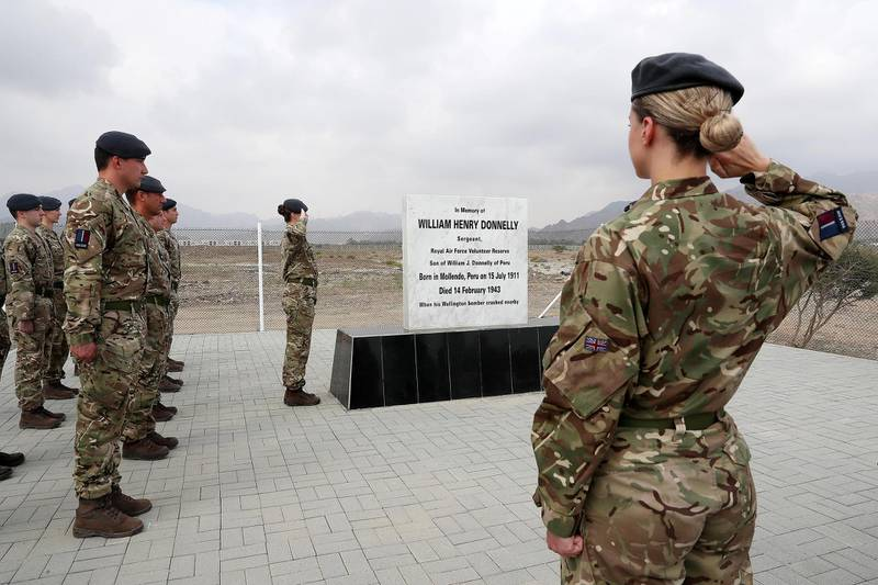 FUJAIRAH , UNITED ARAB EMIRATES , FEB 14  – 2018 :- Soldiers from UK Air Force during the memorial service of William Henry Donnelly , Sergeant , Royal Air Force who was died on 14 February 1943 after his Wellington Bomber crashed during the WW2 in Fujairah. ( Pawan Singh / The National ) For News. Story by John