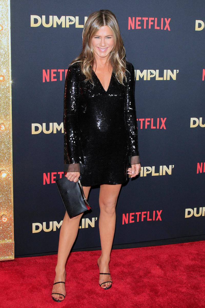 epa07214074 US actress/cast member Jennifer Aniston arrives for the world premiere of the film Dumplin' at the TCL Chinese 6 Theaters in Hollywood, California, USA, 06 December 2018. The movie opens on Netflix and in select theaters 07 December 2018.  EPA-EFE/NINA PROMMER