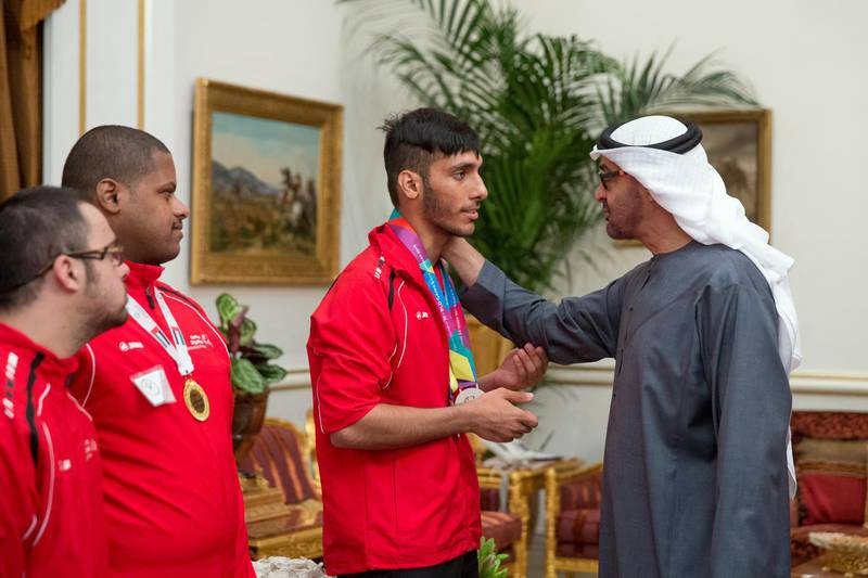 ABU DHABI, UNITED ARAB EMIRATES - January 11, 2016: HH Sheikh Mohamed bin Zayed Al Nahyan Crown Prince of Abu Dhabi Deputy Supreme Commander of the UAE Armed Forces (R), greets a member of the UAE Disabled Sports Federation during a Sea Palace barza.  ( Mohamed Al Hammadi / Crown Prince Court - Abu Dhabi ) ---