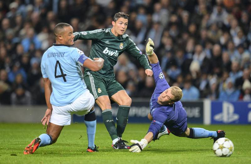 MANCHESTER, ENGLAND - NOVEMBER 21:  Joe Hart of Manchester City dives to save the attempt on goal of Cristiano Ronaldo of Real Madrid during the UEFA Champions League Group D match between Manchester City FC and Real Madrid CF at the Etihad Stadium on November 21, 2012 in Manchester, England. (Photo by Shaun Botterill/Getty Images)