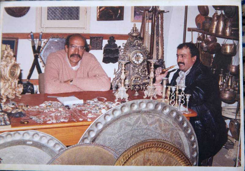 A personal photograph showing Palestinian merchant Joma Al Zaeem (left) in his copper shop , which was just s heavily damaged by an Israeli airstrike missiles  that damaged the ÒArts and Crafts Village , a museum managed by the City Council in Gaza. It was   founded by late Palestinian President Yasser Arafat in 1998, with financial support from the United Nations Development Program. Last Saturday Israeli planes carried out attacks on dozens of targets in the Gaza Strip in the most extensive Israeli military assault since the 2014 ÒOperation Protective EdgeÓ in which over 2,200 Palestinians were killed. (Photo by Heidi Levine for The National).