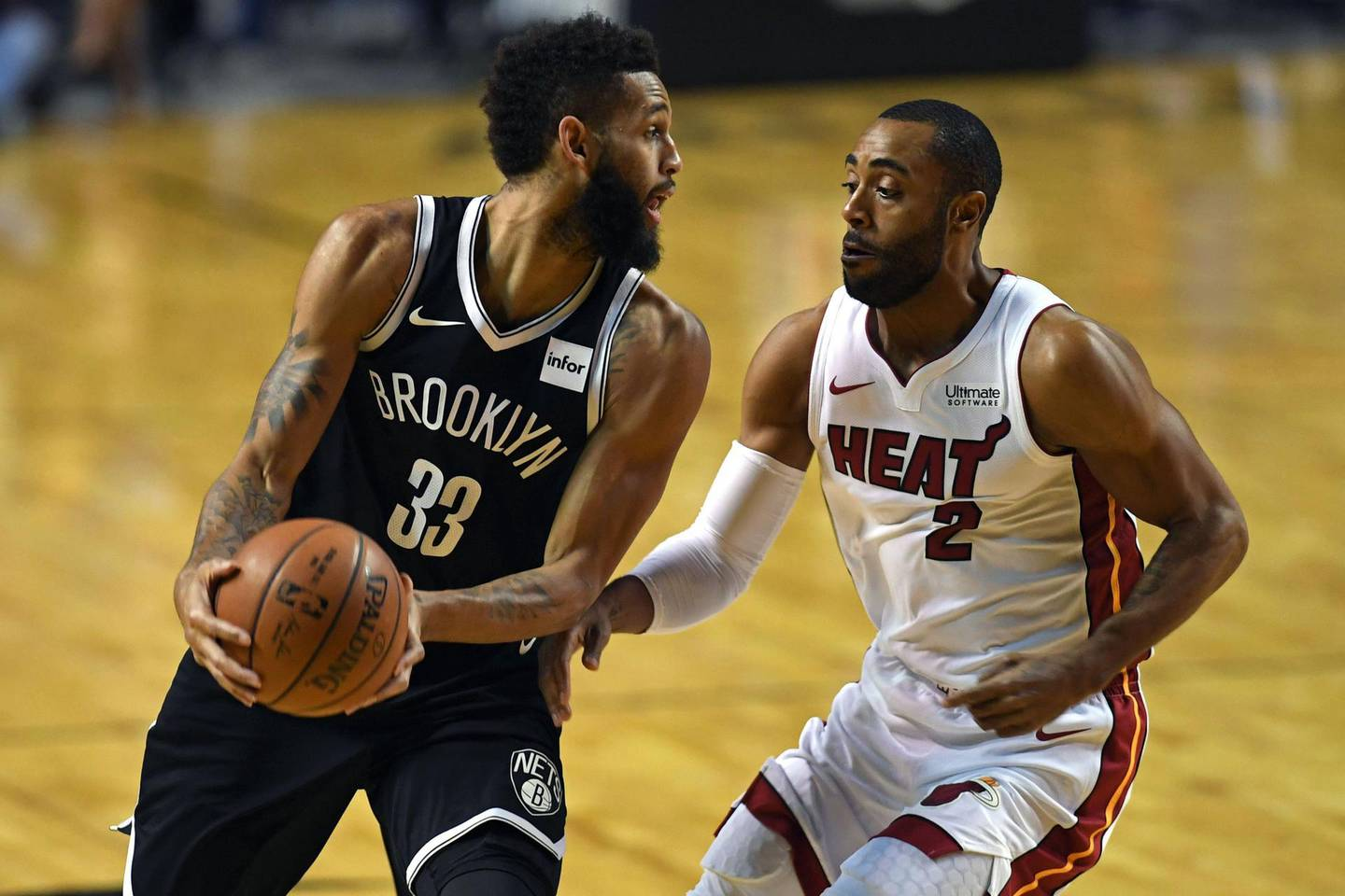 Brooklyn Nets' Allen Crabbe (L) vies for the ball with Miami Heat's Wayne Ellington, during an NBA Global Games match at the Mexico City Arena, on December 9, 2017, in Mexico City. / AFP PHOTO / PEDRO PARDO