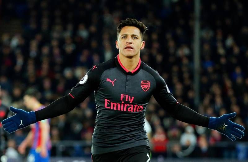 FILE - In this Thursday, Dec. 28, 2017 file photo, Arsenal's Alexis Sanchez celebrates after scoring his side's third goal of the game during their English Premier League soccer match against Crystal Palace at Selhurst Park stadium in London. Alexis Sanchez is close to joining Manchester United in what is set to be a rare swap deal among two of England's top teams that will see Henrikh Mkhitaryan move to Arsenal. Both players were pictured by British newspapers Monday, Jan. 22, 2018 entering an office in Liverpool to update their work permits. (AP Photo/Alastair Grant, file)