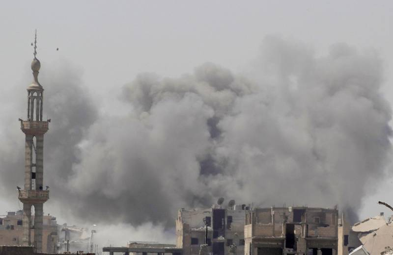 Smoke rises after an air strike during fighting between members of the Syrian Democratic Forces and Islamic State militants in Raqqa, Syria, August 20, 2017. REUTERS/Zohra Bensemra