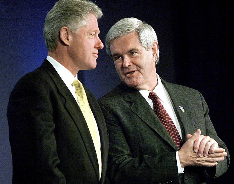 (FILES): This 04 June 1998 file photo shows then House Speaker Newt Gingrich (R) conferring with US President Bill Clinton (L) during introductions at the National Summit on Retirement Savings at the Hyatt Hotel in Washington, DC. Gingrich, a potential Republican presidential candidate in 2008, confessed to cheating on his wife at about the same time US President Bill Clinton was being impeached over his White House affair with Monica Lewinsky. Gingrich admitted to the extra-marital affair during an interview aired 09 March 2007 with conservative Christian leader James Dobson.  AFP PHOTO/FILES/Paul J. RICHARDS (Photo by PAUL J. RICHARDS / AFP)