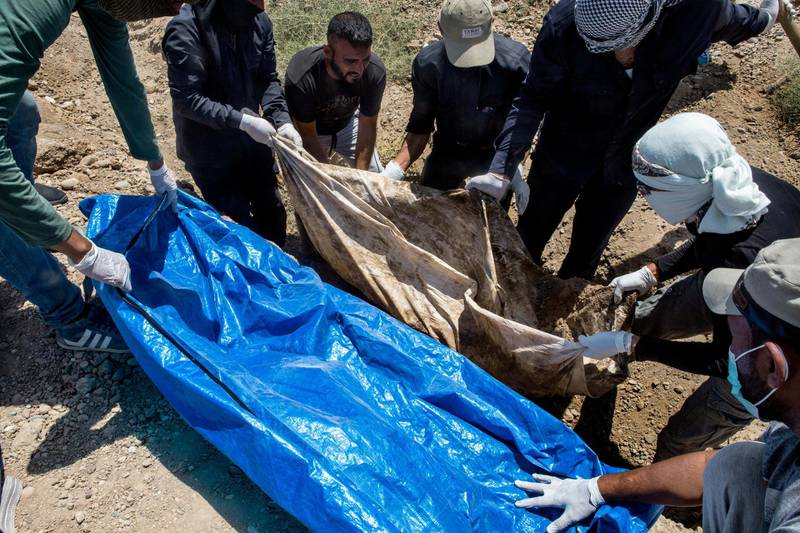 Raqqa, Syria, Zoo park in al-Furat neighborhood. Whenever a body is extracted from the earth, the medical examiner takes care of making the first considerations. Looking at the teeth or what remains of the body tries to identify sex and age.