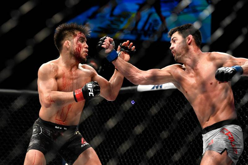 JACKSONVILLE, FLORIDA - MAY 09: Henry Cejudo (L) of the United States fights Dominick Cruz (R) of the United States in their bantamweight title fight during UFC 249 at VyStar Veterans Memorial Arena on May 09, 2020 in Jacksonville, Florida.   Douglas P. DeFelice/Getty Images/AFP
