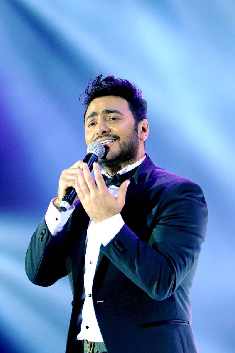 """Egyptian pop sensation Tamer Hosny performs on stage in the western Saudi city of Jeddah on March 30, 2018. - Thousands of fans were taken by surprise when tickets for Hosny's first-ever Saudi concert came with the edict that dancing was """"strictly prohibited"""". (Photo by Amer HILABI / AFP)"""