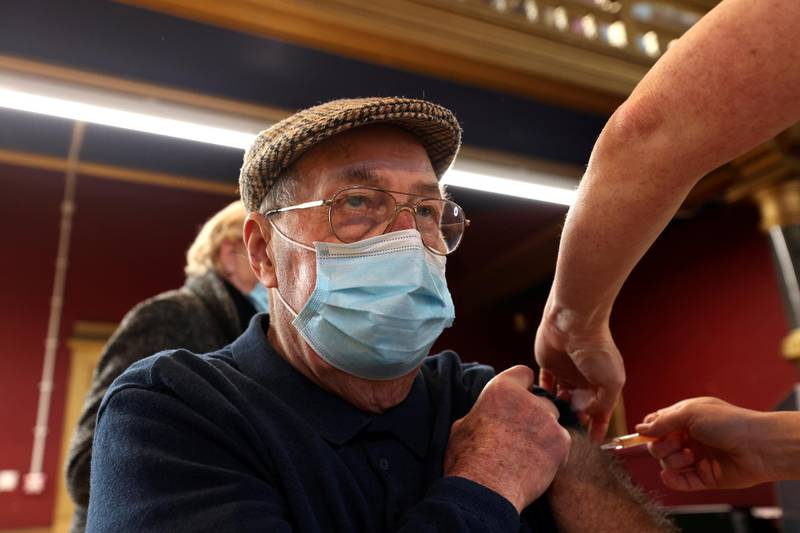 A man receives a dose of COVID-19 vaccine at a community vaccination centre at Hartlepool Town Hall, amid the outbreak of coronavirus disease (COVID-19) in Hartlepool, Britain, January 31, 2021. REUTERS/Lee Smith