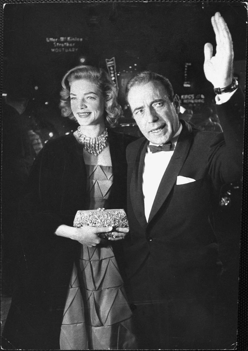 HOLLYWOOD, CA - MARCH 30:  Actor Humphrey Bogart, nominated for Best Actor for his performance in The Caine Mutiny, and his actress wife Lauren Bacall arrive prior to the 27th Annual Academy Awards ceremony on March 30, 1955 at the RKO Pantages Theatre in Hollywood, California. (Photo by George Silk/The LIFE Picture Collection via Getty Images)