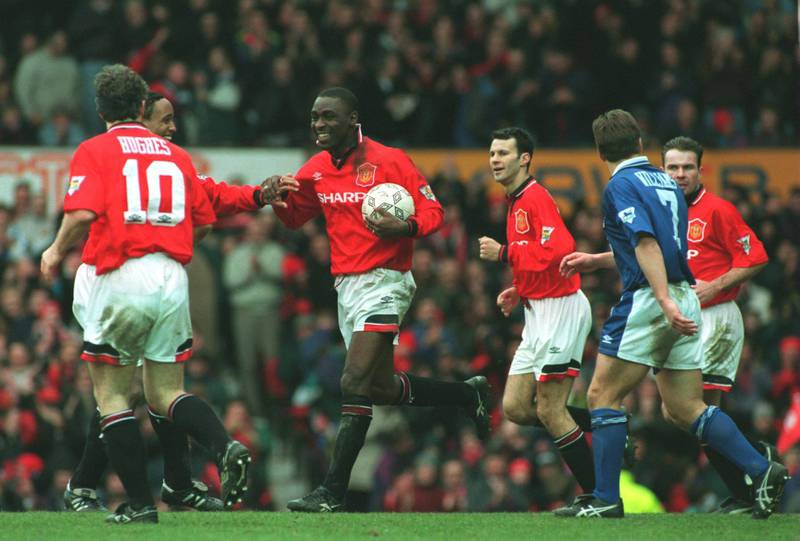 4 MAR 1995:  ANDY COLE OF MANCHESTER UNITED IS CONGRATULATED BY HIS TEAM MATES AFTER HE SCORES HIS SECOND GOAL FOR MAN UTD DURING THEIR 9-0 VICTORY OVER IPSWICH TOWN IN THE FA PREMIERSHIP MATCH AT OLD TRAFFORD, MANCHESTER. Mandatory Credit: Anton Want/ALLSPORT
