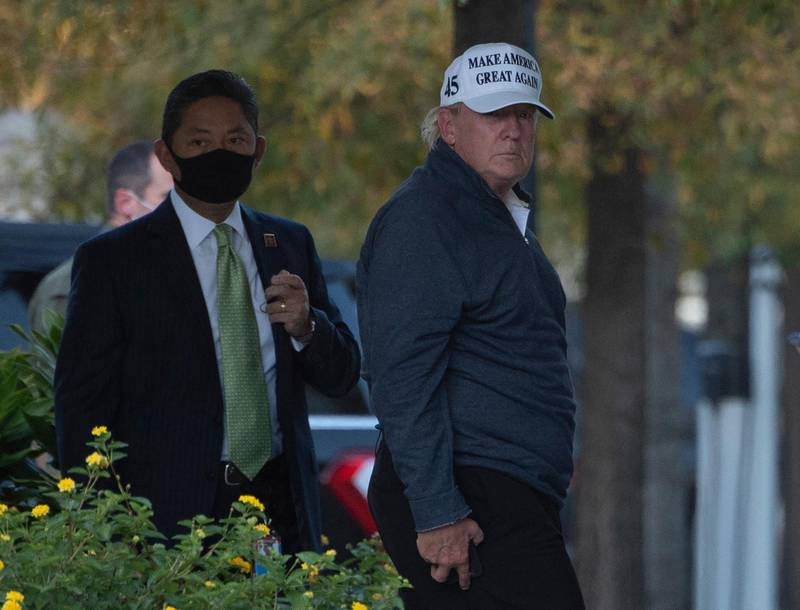 President Donald Trump returns to the White House from playing golf in Washington, DC on November 7, 2020, after Joe Biden was declared the winner of the 2020 presidential election. - Joyous celebrations erupted in Washington on Saturday after Joe Biden was declared winner of the US presidency, as several people poured into the streets of the US capital -- some of them chanting, cheering and singing in front of the White House. (Photo by ANDREW CABALLERO-REYNOLDS / AFP)