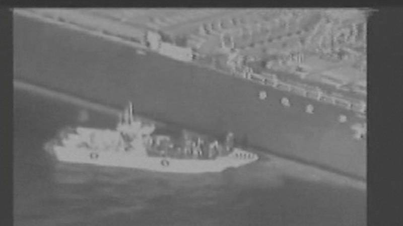 Still image taken from a U.S. military handout video purports to show Iran's Revolutionary Guard (IRGC) removing an unexploded limpet mine from the side of the Kokuka Courageous Tanker, June 13, 2019. Courtesy U.S. Military/Handout via REUTERS ATTENTION EDITORS - THIS IMAGE HAS BEEN SUPPLIED BY A THIRD PARTY.