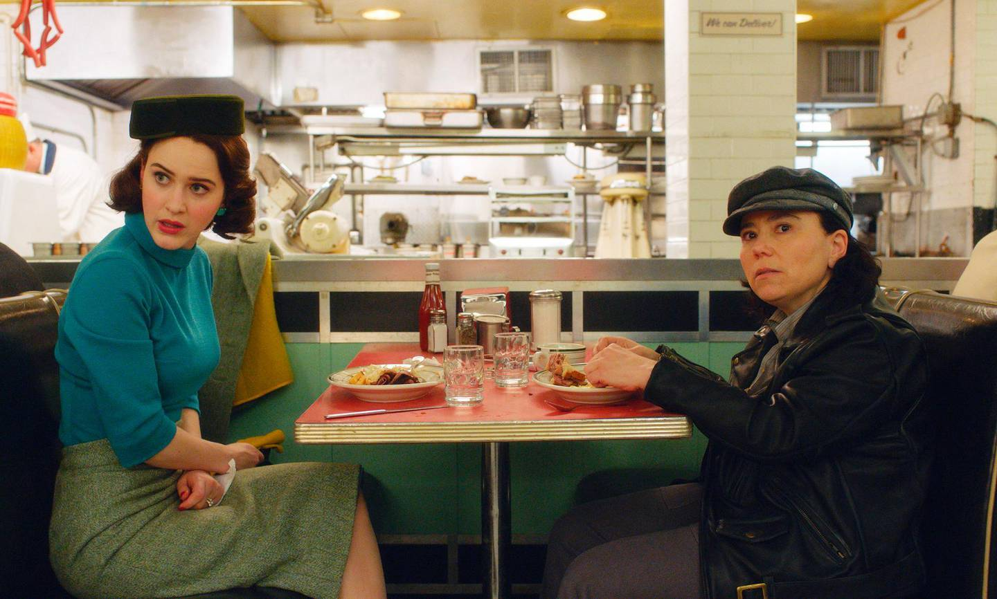 """This image released by Amazon shows Rachel Brosnahan, left, and Alex Borstein in a scene from """"The Marvelous Mrs. Maisel.""""   On Tuesday, July 16, 2019, Borstein was nominated for an Emmy Award for outstanding supporting actress in a comedy series. (Amazon via AP)"""