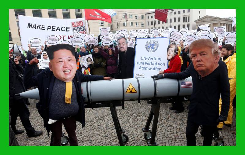 BERLIN, GERMANY - NOVEMBER 18:  An activist with a mask of Kim Jong-un, chairman of the Workers' Party of Korea and supreme leader of North Korea (L), and another with a mask of U.S. President Donald Trump, march with a model of a nuclear rocket during a demonstration against nuclear weapons on November 18, 2017 in Berlin, Germany. About 700 demonstrators protested against the current escalation of threat of nuclear attack between the United States of America and North Korea. The event was organized by peace advocacy organizations including the International Campaign to Abolish Nuclear Weapons (ICAN), which won the Nobel Prize for Peace this year.  (Photo by Adam Berry/Getty Images)***BESTPIX***