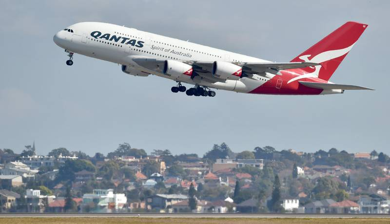 """A Qantas Airbus A380 takes off from the airport in Sydney on August 25, 2017. Australia's Qantas unveiled plans for the world's longest non-stop commercial flight on August 25, 2017 calling it the """"last frontier of global aviation"""", as it posted healthy annual net profits on the back of a strong domestic market. / AFP PHOTO / PETER PARKS"""