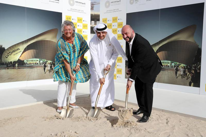 DUBAI , UNITED ARAB EMIRATES , APRIL 29  – 2018 :- Left to Right – Maggy Nagel , General Commissioner of the Luxembourg Pavilion and President of the Board of Management of Luxembourg at Expo 2020 Dubai , Najeed Mohammed Al Ali , Executive Director , Dubai Expo 2020 Bureau and Etienne Schneider , Deputy Prime Minister of Luxembourg during the ground breaking ceremony of the Luxembourg Pavilion at the Expo 2020 site in Dubai. ( Pawan Singh / The National ) For News. Story by Mustafa