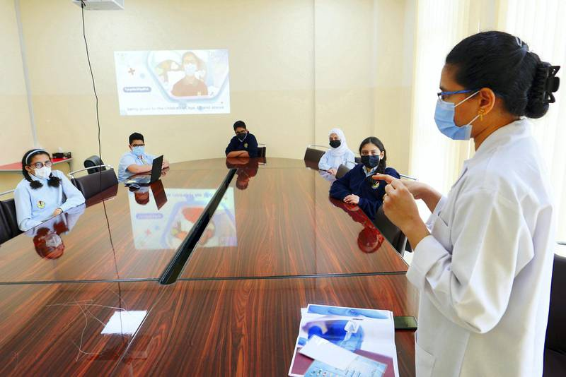 Blessy Jinu, staff nurse explaining about the Covid 19 vaccine to the students at the Al Shola American School in Ajman on June 8 , 2021. Pawan Singh / The National. Story by Salam