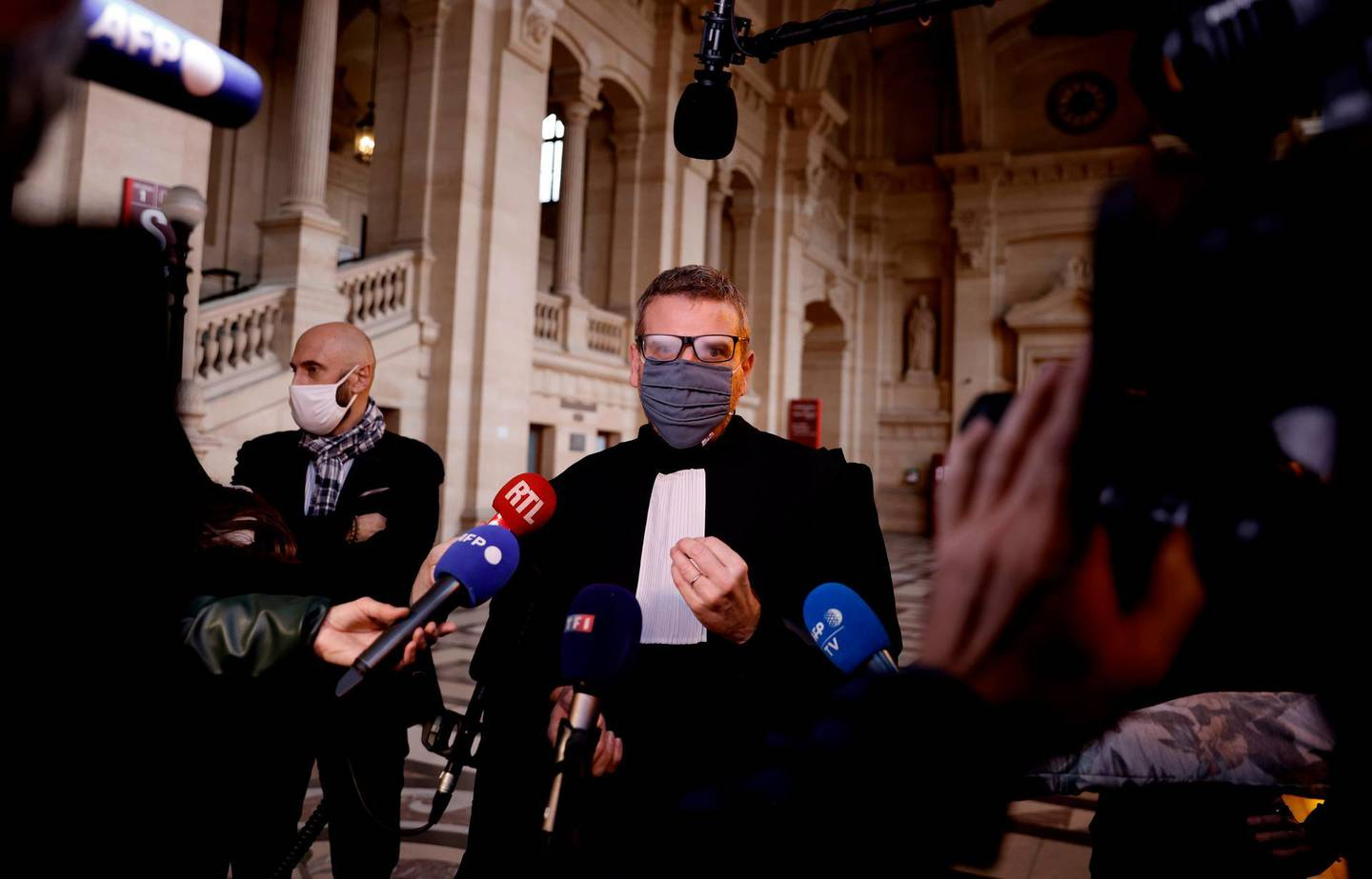 """French lawyer Thibault de Montbrial, who is representing US soldiers who foiled a terror attack on an Amsterdam-Paris train in 2015, speaks to journalists at The Paris Courthouse in Paris on November 16, 2020, before the start of the trial of a man accused of the attack. Ayoub El Khazzani was tackled by passengers after emerging heavily armed from a toilet on a Thalys Amsterdam-Paris high-speed train on August 21, 2015. The 31-year-old, who joined the Islamic State group in Syria in May 2015, is charged with """"attempted terrorist murder"""" and will be joined in the dock at the special anti-terror court by three other men accused of helping him. The passengers included two off-duty US servicemen, Spencer Stone and Alek Skarlatos, whose actions were later made into a film by Hollywood director Clint Eastwood. The trial is scheduled to last until December 17. / AFP / THOMAS COEX"""