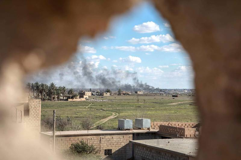 ISIS-held Baghouz, in Syria's Deir Ezzour province, viewed from an SDF frontline position on 3 March 2019. Campbell MacDiarmid