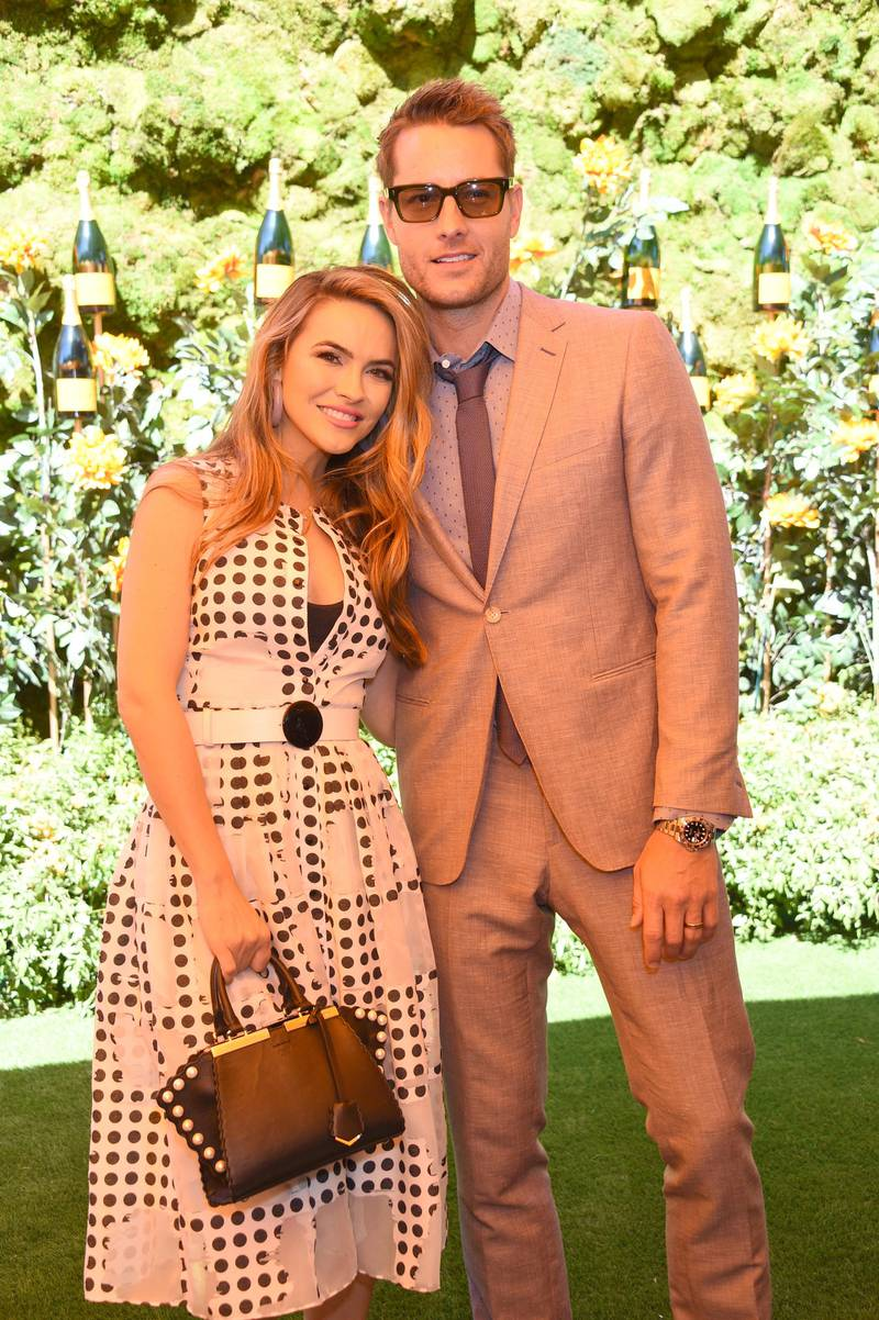 PACIFIC PALISADES, CALIFORNIA - OCTOBER 05: (L-R) Chrishell and Justin Hartley attend the 10th Annual Veuve Clicquot Polo Classic Los Angeles at Will Rogers State Historic Park on October 05, 2019 in Pacific Palisades, California.   Gregg DeGuire/Getty Images/AFP (Photo by GREGG DEGUIRE / GETTY IMAGES NORTH AMERICA / Getty Images via AFP)