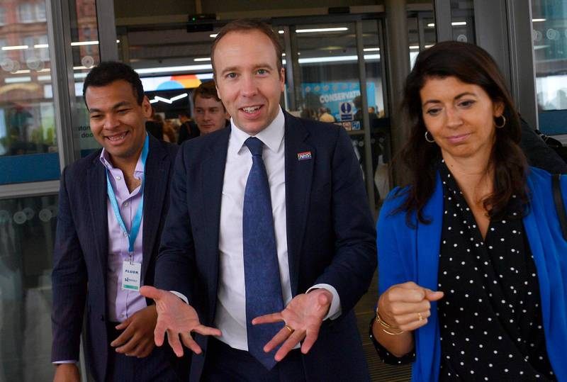 epa09302499 (FILE) - Britain's Health Secretary Matt Hancock (C) and aide Gina Coladangelo (R) attend the Conservative Party Conference  in Manchester, Britain, 29 September 2019 (reissued 26 June 2021). In a statement sent to media, Hancock apologized for breaking social distancing rules after a video emerged of him appearing to hug and kiss his aide Gina Coladangelo.  EPA/NEIL HALL *** Local Caption *** 55505745