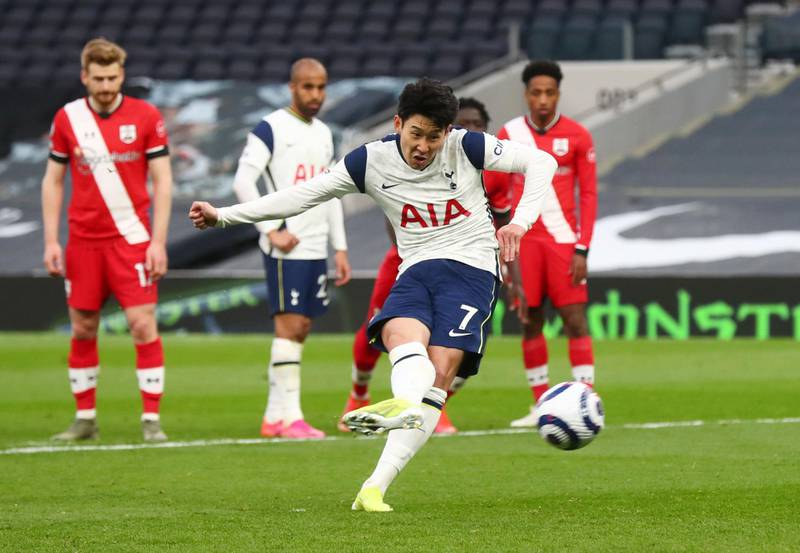 Soccer Football - Premier League - Tottenham Hotspur v Southampton - Tottenham Hotspur Stadium, London, Britain - April 21, 2021 Tottenham Hotspur's Son Heung-min scores their second goal from the penalty spot Pool via REUTERS/Clive Rose EDITORIAL USE ONLY. No use with unauthorized audio, video, data, fixture lists, club/league logos or 'live' services. Online in-match use limited to 75 images, no video emulation. No use in betting, games or single club /league/player publications.  Please contact your account representative for further details.