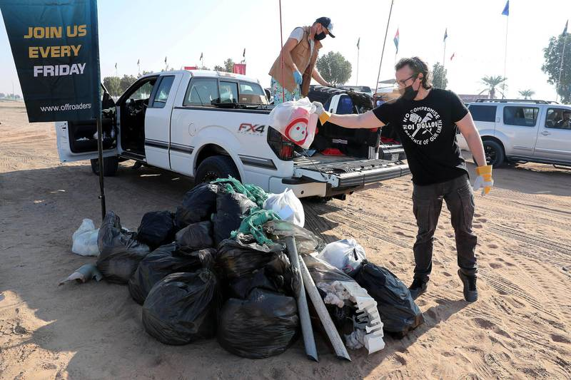 SHARJAH, UNITED ARAB EMIRATES , January 16– 2021 :- Members of the off roaders club unloading the trash during the desert clean up drive at the Al Badayer desert area in Sharjah. (Pawan Singh / The National) For News/Stock/Online/Instagram/Standalone/Big Picture. Story by Nick Webster